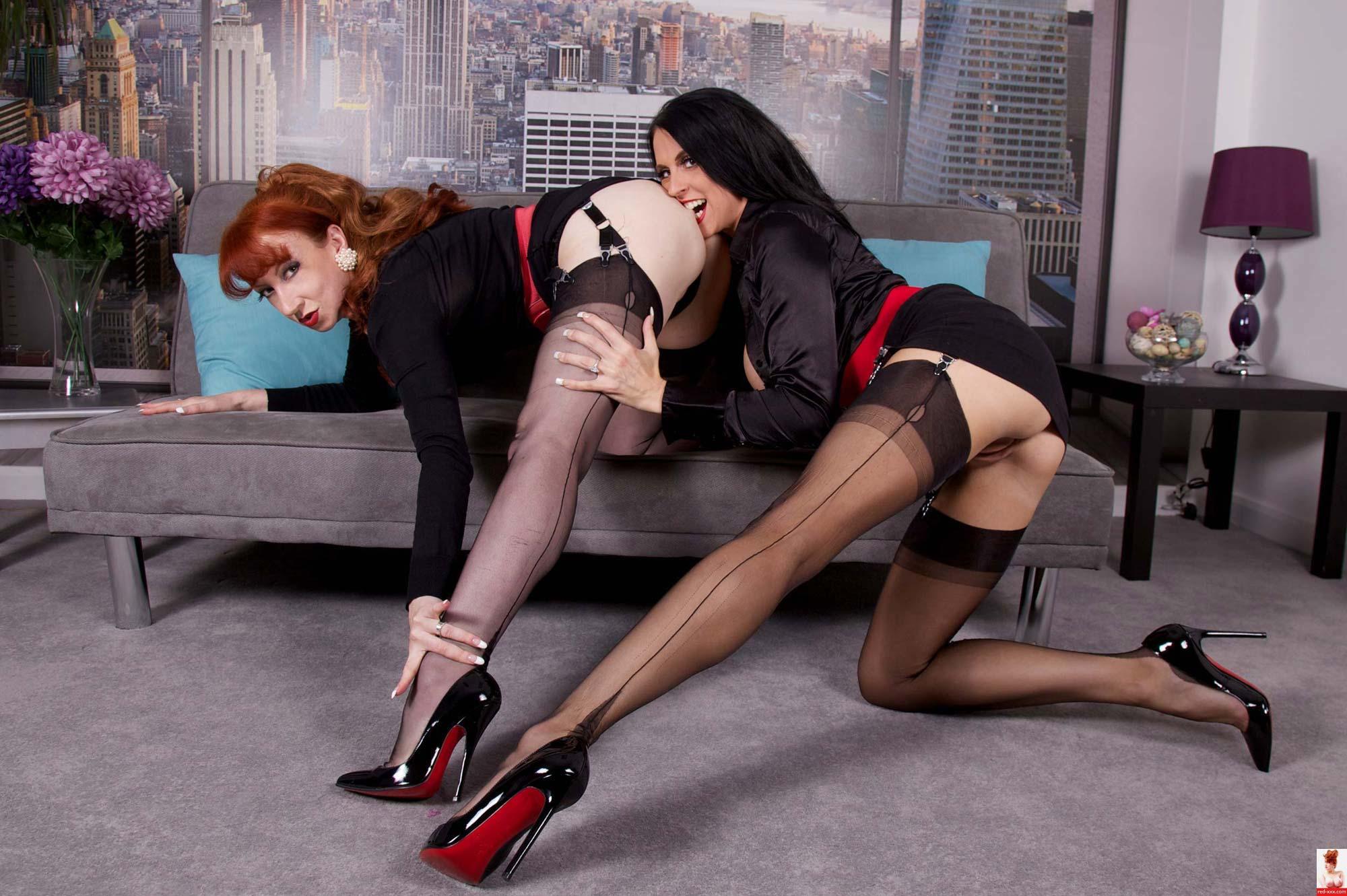 Sexy redhead in black seams